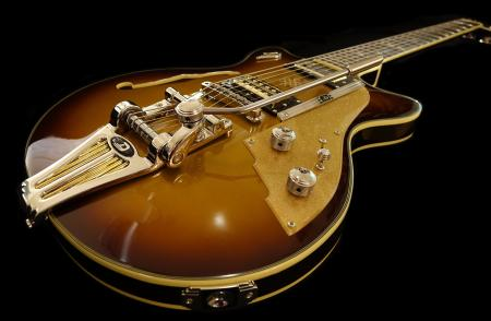 Brown and Gray Electric Guitar