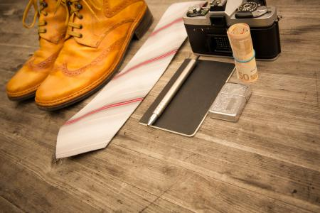 Brown Leather Oxford Wingtip Shoes Beside White and Pink Necktie on Brown Wooden Table