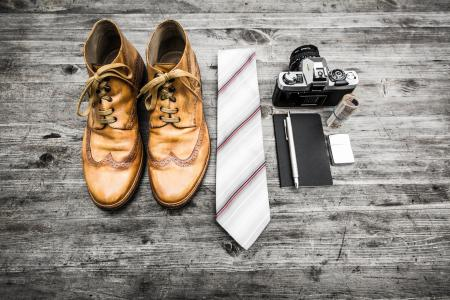 Brown Leather Oxford Wingtip Shoes Beside White and Red Necktie