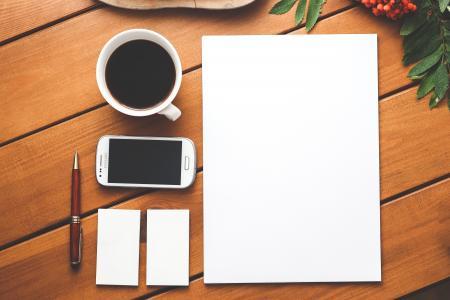 Business identity. Blank stationery set on wood background