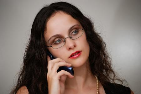 Business woman talking on a phone