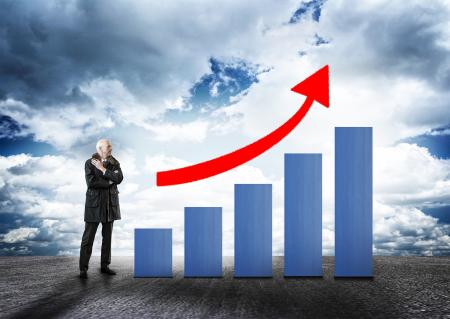 Businessman and Bar Chart with Arrow - Money Growth Concept