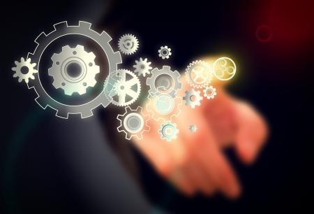 Businessman and Cogwheels on Virtual Screen - Work Concept