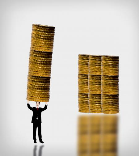 Businessman carrying a gold coin stack