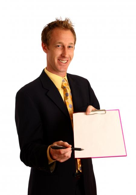 Businessman holding a clipboard and pen