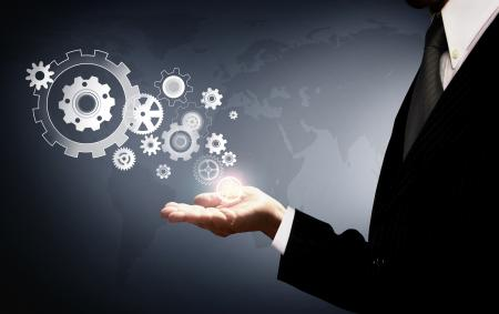 Businessman Holding Virtual Cogwheels - Business and Work