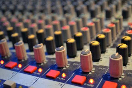 Buttons on an audio mixing board