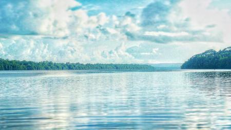 Calm Lake Under Cloudy Sky