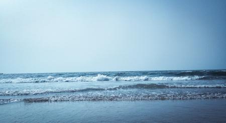 Calm Water on Seashore at Daytime