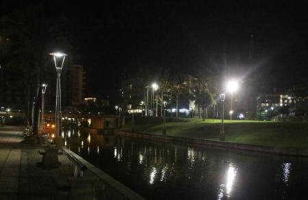 Canal reflecting city lights