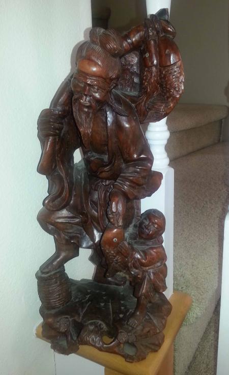 Carved Fisherman