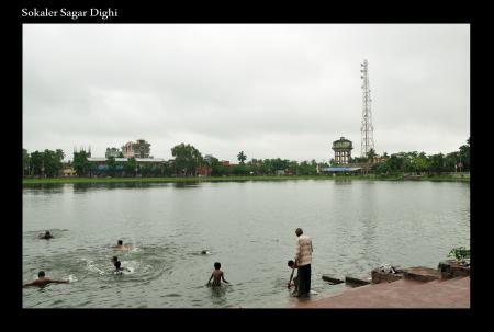 Children Bathing in a Pond