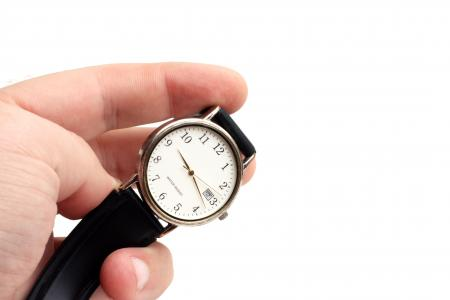 Close-up of a hand holding a watch