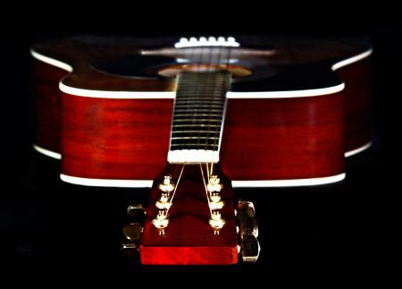 Close Up Photography of Red Wooden Guitar Head Stock