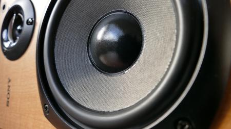 Closed Up Photography of Brown Wooden Framed Sony Speaker