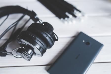 Closeup of  headphones with smart phone