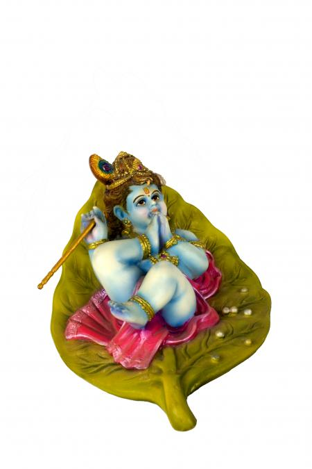 Colorful clay idol of lord krishna