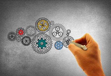 Concept of Work - A Person Drawing Cogwheels