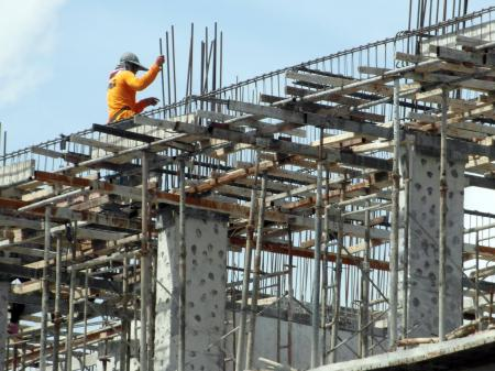Construction Worker High Up