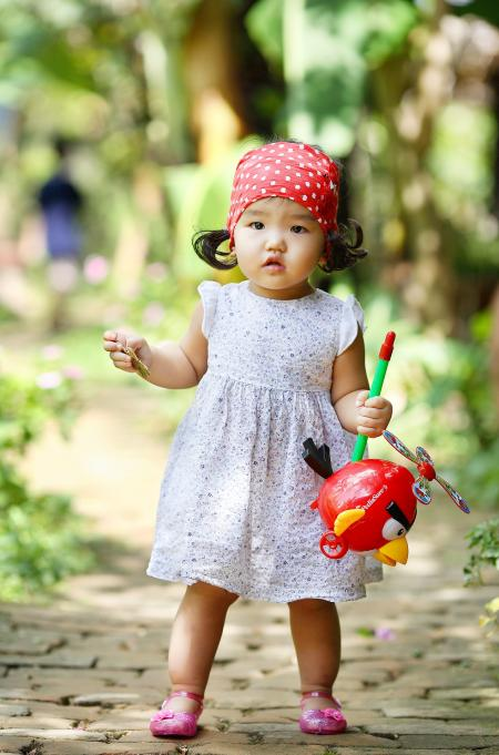 Cute Baby Girl with Angry Birds Toy