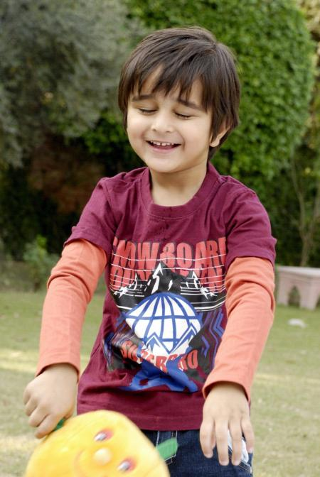 Cute Kid Playing in the Lawn