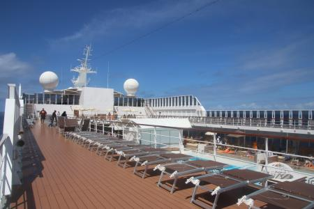 Deck of the ship with sun beds and pool