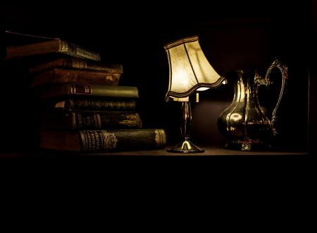 Desk with Lamp, Pitcher, and Vintage Books