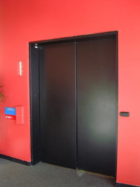 Red Elevator Door