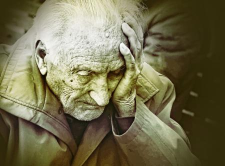 Emotional Colorized Portrait of Elderly Man Worrying