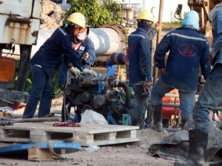 Engineers work on a pipeline