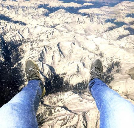 Feet hanging over the Alps