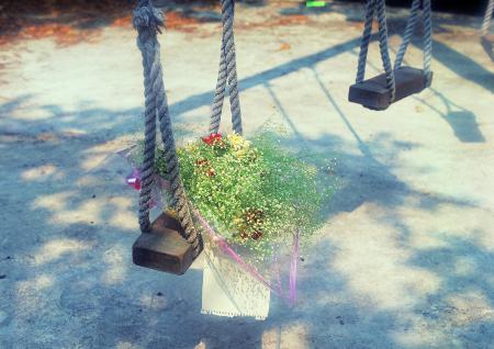 Flower on swing set
