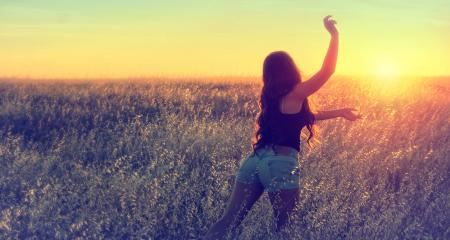 Girl Running in the Field at Dusk during Summer - Joy and Vitality