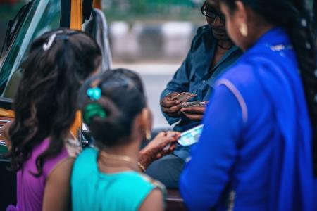 Girls Near Man Holding Money