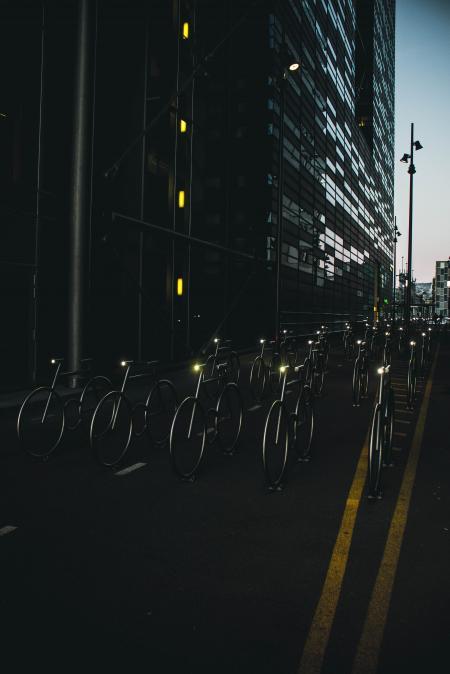 Gray Bike on Road Between Buildings
