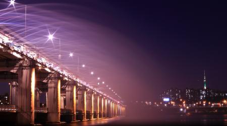 Gray Bridge With Street Light during Nighttime