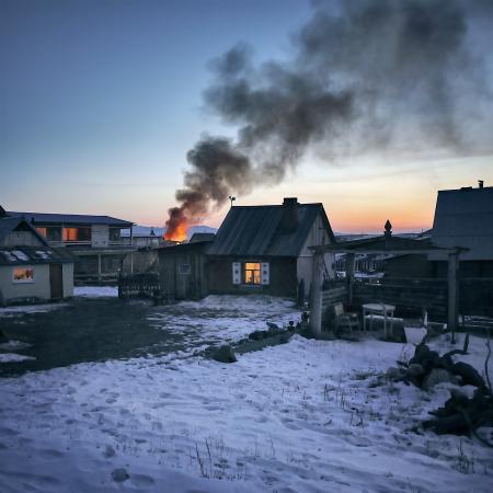 Gray Wooden House Burning