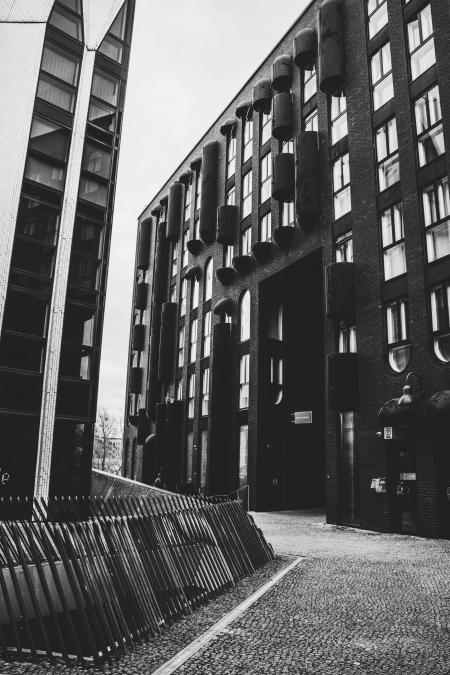 Grayscale Photo of Concrete Buildings