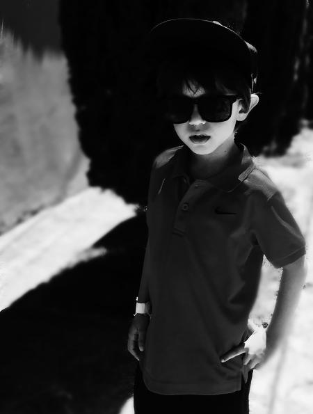 Grayscale Photography of Boy Wearing Polo Shirt and Sunglasses