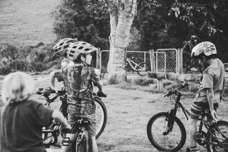 Grayscale Photography of Children Riding Bicycles