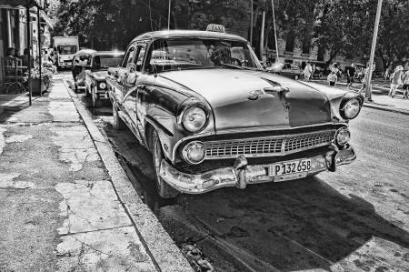 Grayscale Photography of Vintage Car Beside Pavement