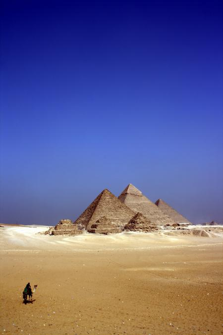 Grey Concrete Pyramids on the Middle of the Dessert during Daytime
