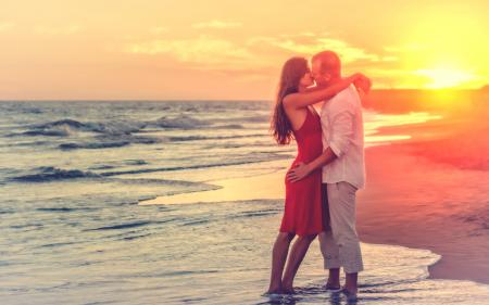 Hazy Looks - Romantic Couple at the Beach at Sunset