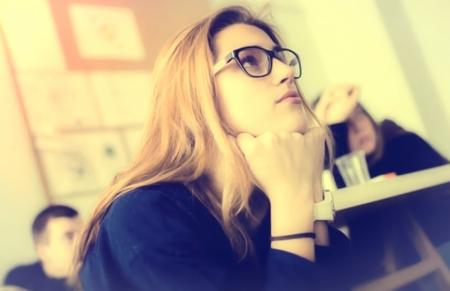 Hazy Vintage Looks - Young Woman with Glasses - Attentive - Classroom