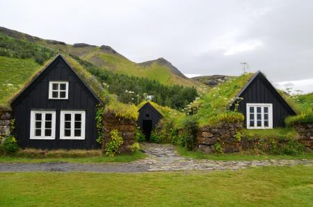 House on Green Landscape Against Sky