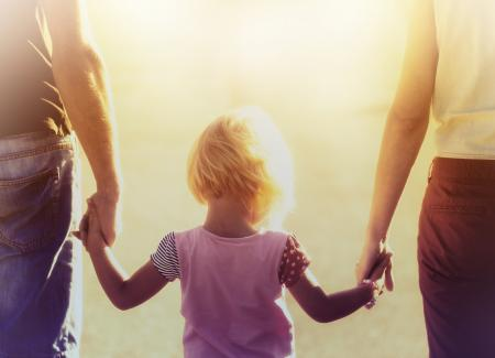 Into the Light - Parents Hold Hands with their Child