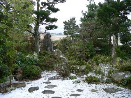 Light snowfall in a Japanese garden