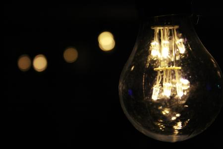 Lighted Bulb during Night Time