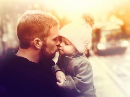 Loving Father Kissing Baby Girl - Colorized