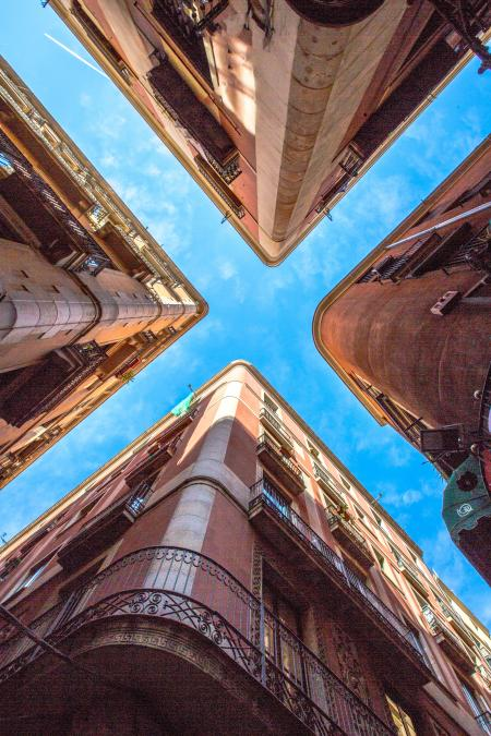 Low Angle Photo of Four Brown Concrete Buildings